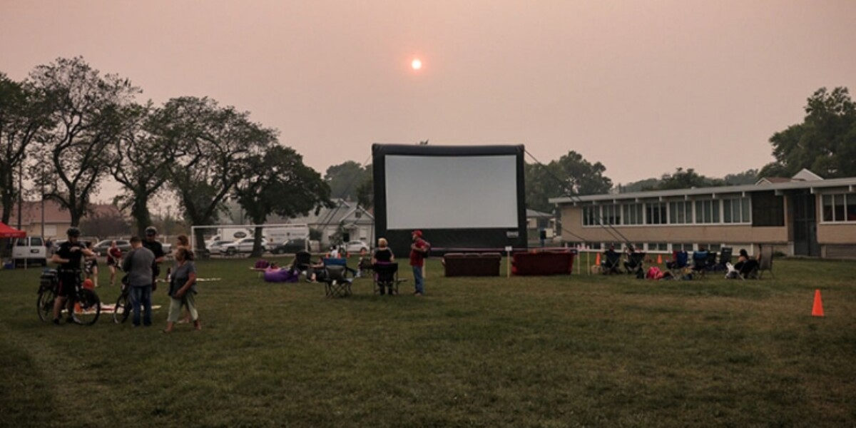 Community members getting ready to enjoy a movie at dusk in Caboto Park on August 10. Todd Homan